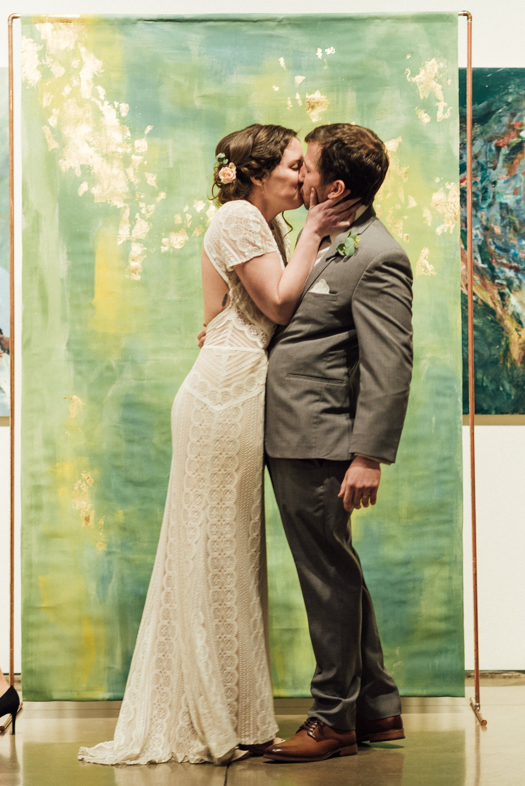 First kiss at Space Gallery wedding ceremony-Colorado Kate Photography
