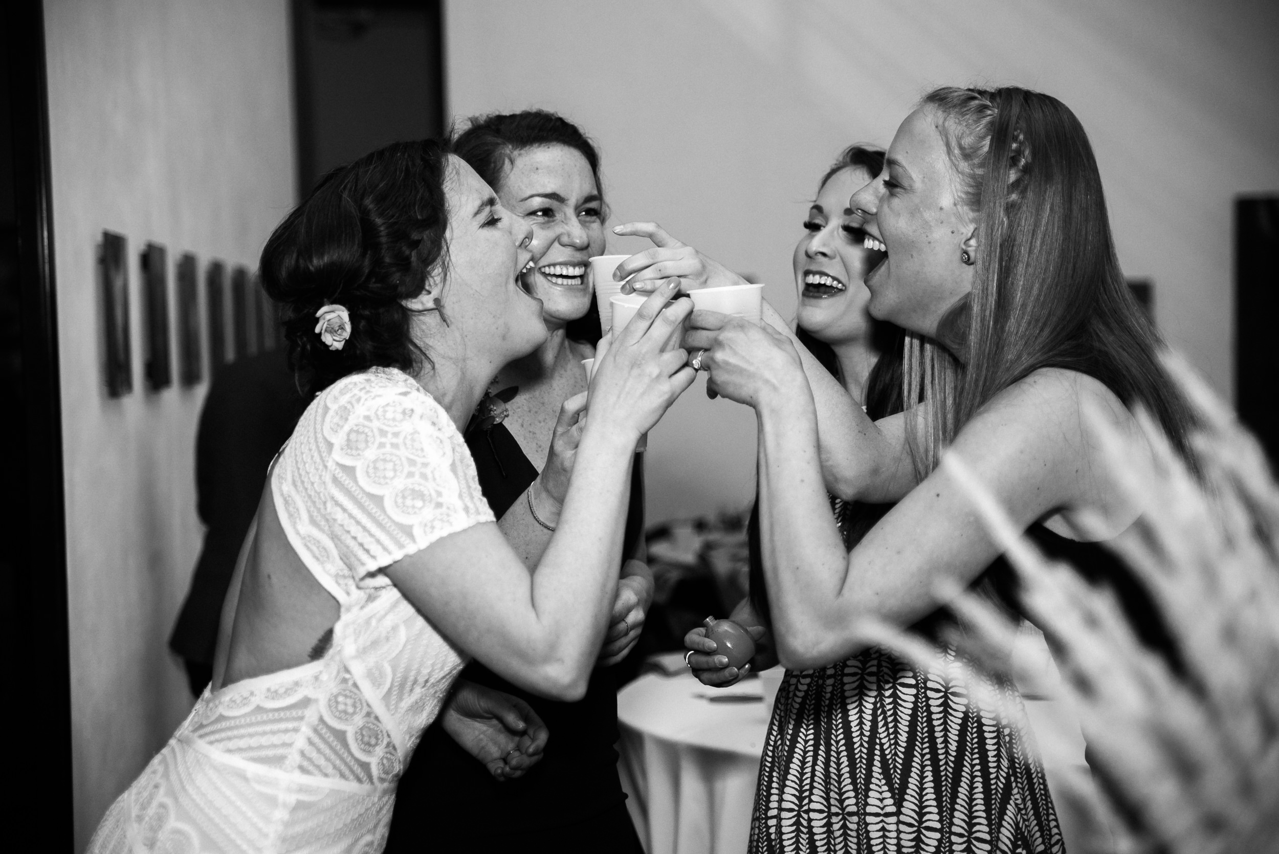 Girl time at the Space Gallery wedding reception. Colorado Kate Photography.