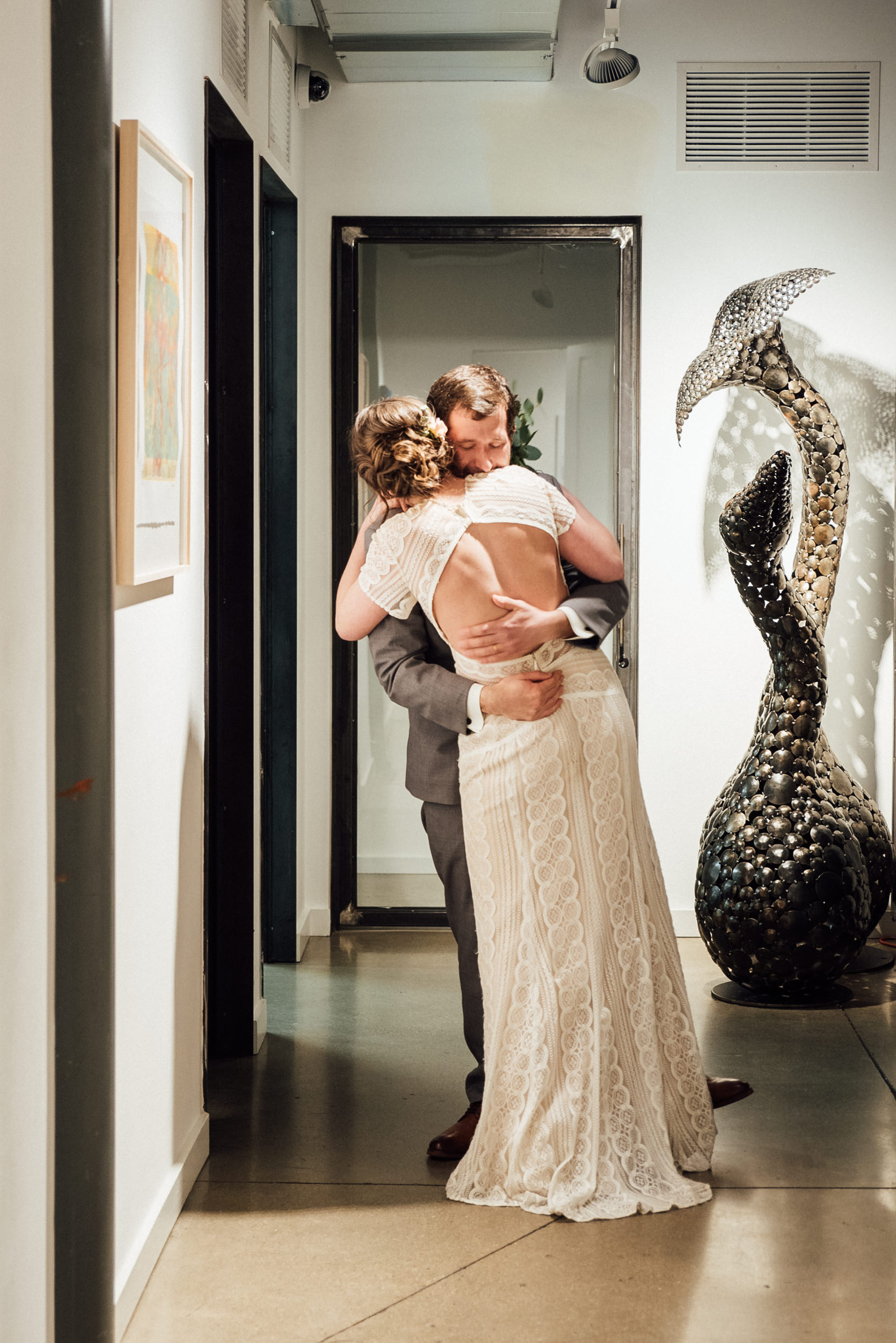 Emotions run high at the Space Gallery after wedding ceremony-Colorado Wedding Photographers