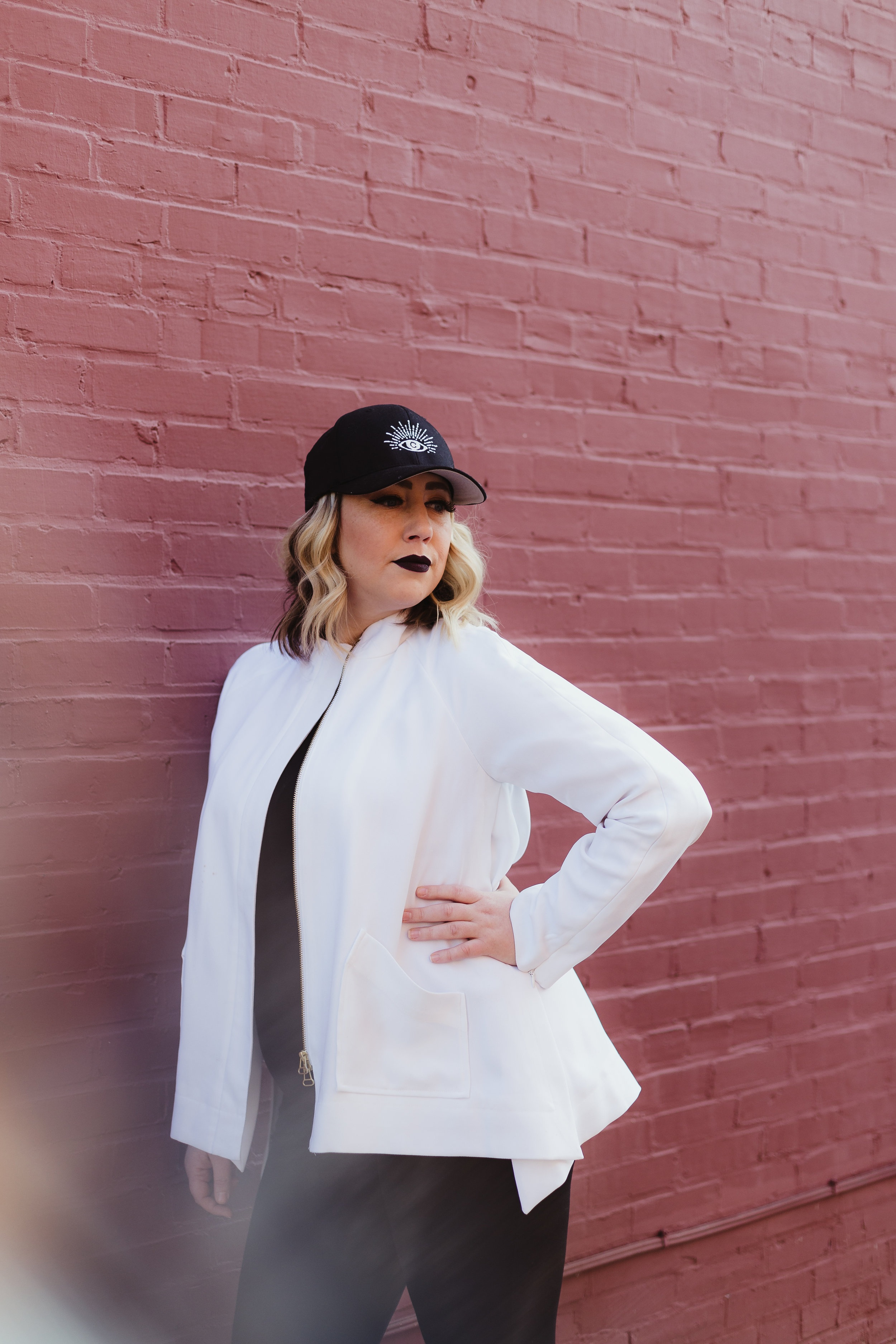 Baseball Hat - Not just for the gym or sporting events. A baseball hat is the perfect accessory for this look. A black tank, jeans, zip up and sneakers make your favorite hat the star of the show. So good for a day of errands and lunch.