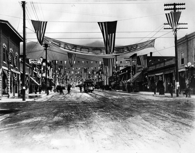 Parade-Monrovia-Day-Celebration-on-circa-1910.-Both-the-W.-H.-Evans-Building-and-the-First-National-Bank-are-shown-they-were-finished-in-1909.-Bakers-Pharmacy.jpg