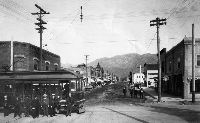 Rail-Electric-street-car-at-Myrtle-Avenue-and-Olive-Street-Monrovia-circa-1900.-Brick-building-on-left-is-American-National-Bank-fourth-man-from-the-right-is-E-J-Lucky-Baldwin.jpg