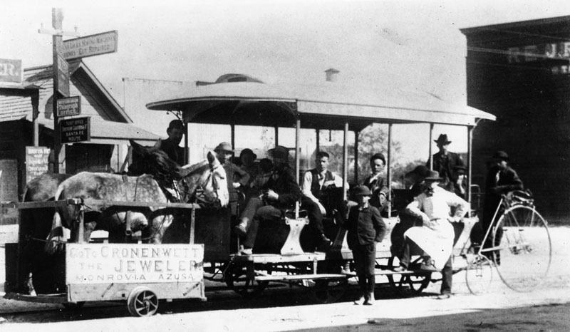 Rail-Mule-car-with-passengers-in-Monrovia-circa-the-1884.-The-mules-are-loaded-on-the-platform-as-the-car-is-ready-to-coast-down-the-hill-on-Myrtle-Avenue-to-the-Santa-Fe-station.-On-.jpg