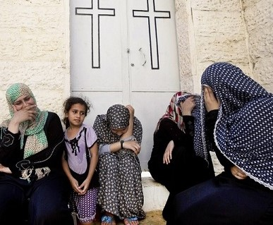 Muslim women come to pray in a church