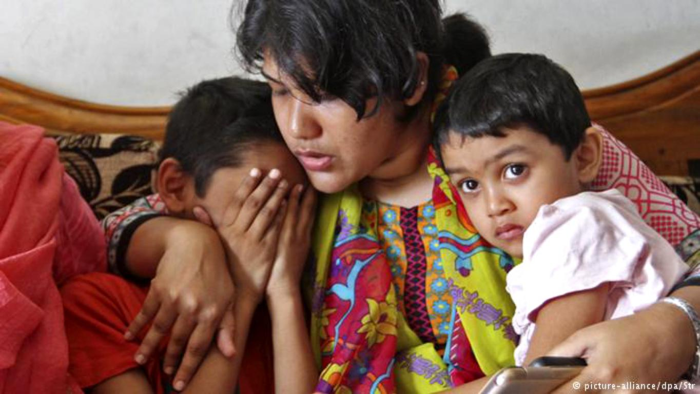 A relative consoles Ms. Khanam's children following her death