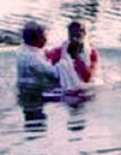 Sayujya being baptised