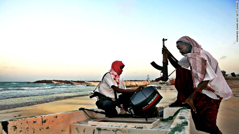 Armed Somali pirates preparing to attack a ship (AFP/GETTY IMAGE)