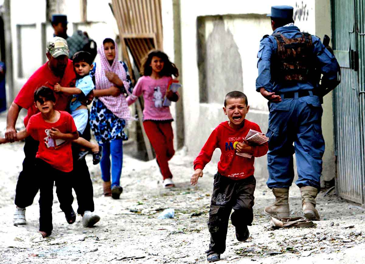 Atrocities in Afghanistan continue; here, Children run away after an explosion in Kabul in May, 2013 (REUTERS)