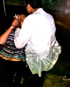 Pastor Peter baptising a new believer