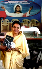 Chandra Devi recieving her new Bible