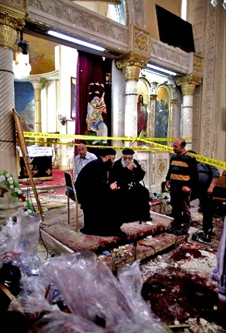 Coptic priests among the ruins of their church in Tanta, Egypt