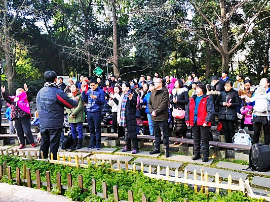 Christians meeting in a public park in China earlier this year after their services were shut down and their leaders taken away.   look closely :  many have packed bags next to them as they worship. They brought their clothes and personal items to the open-air meeting in case they were arrested and taken to prison.
