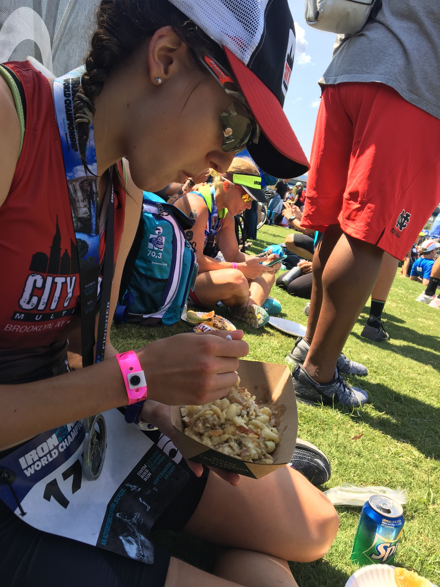 Covered in Gatorade, water-logged, sweat, an athlete eating. Photo credit:Gerry