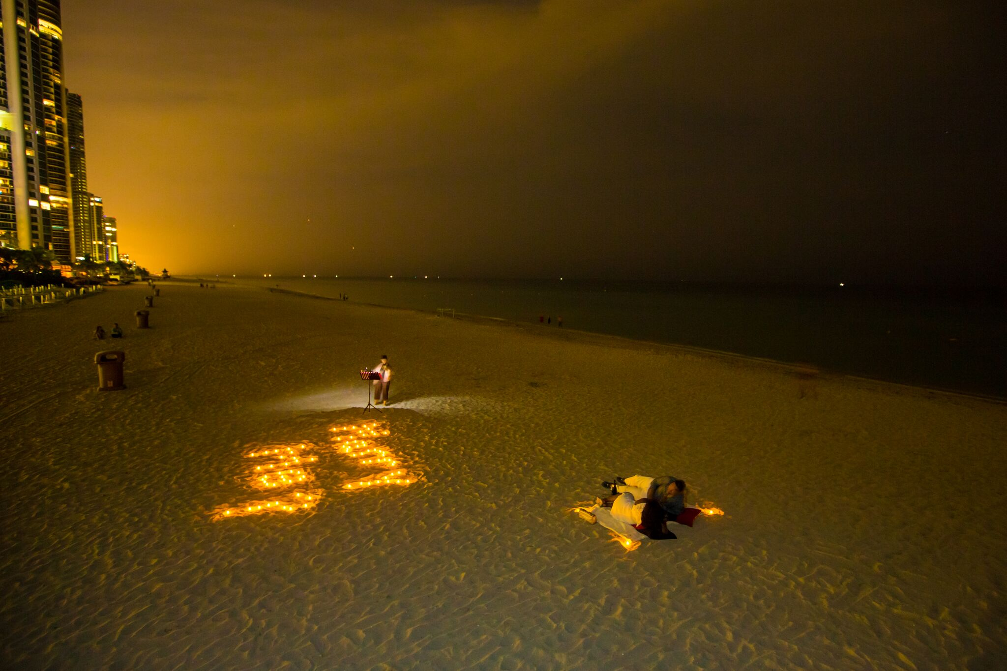 Romantic candlelit beach marriage proposal