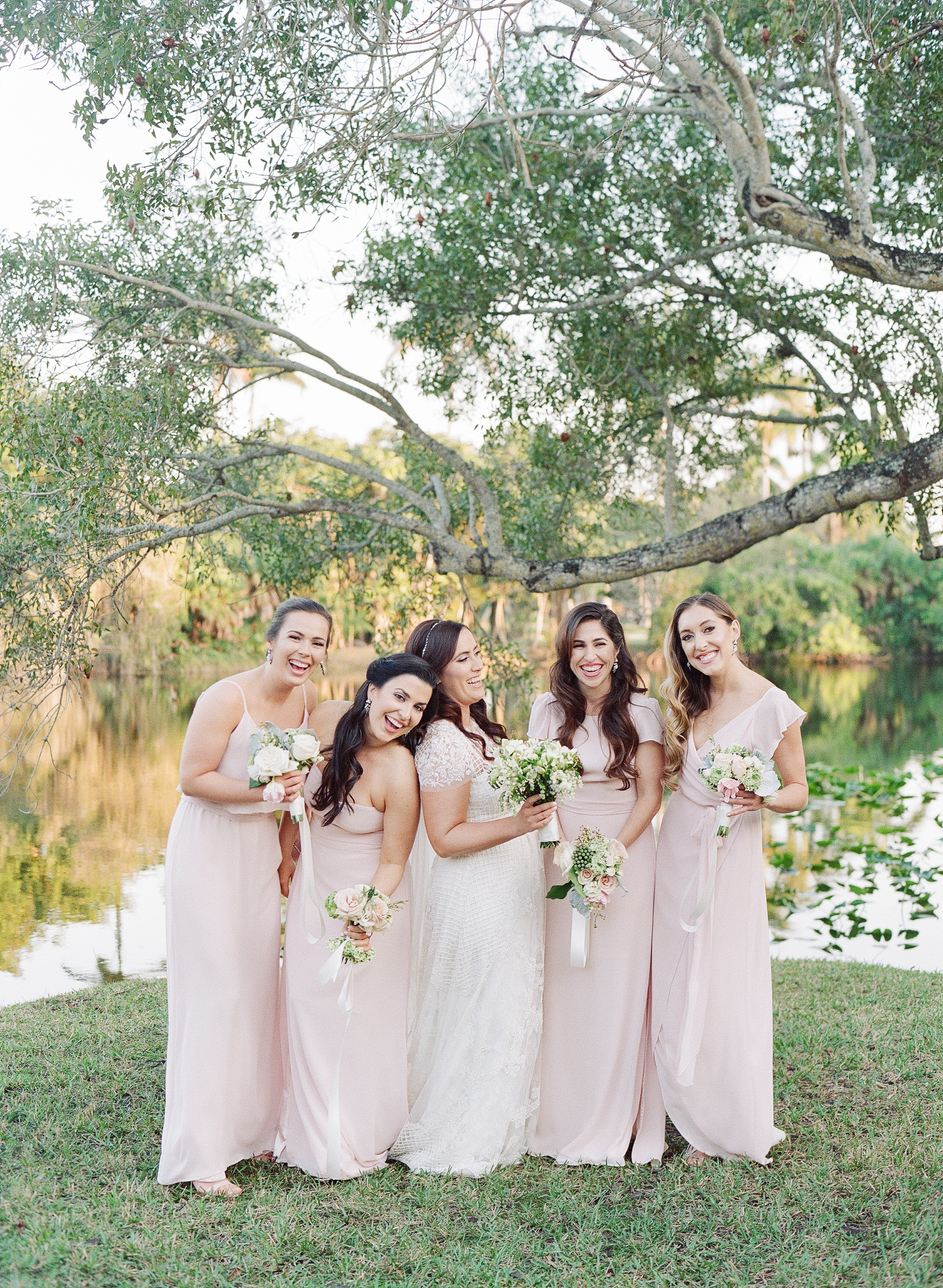 Mismatching blush bridesmaid dresses