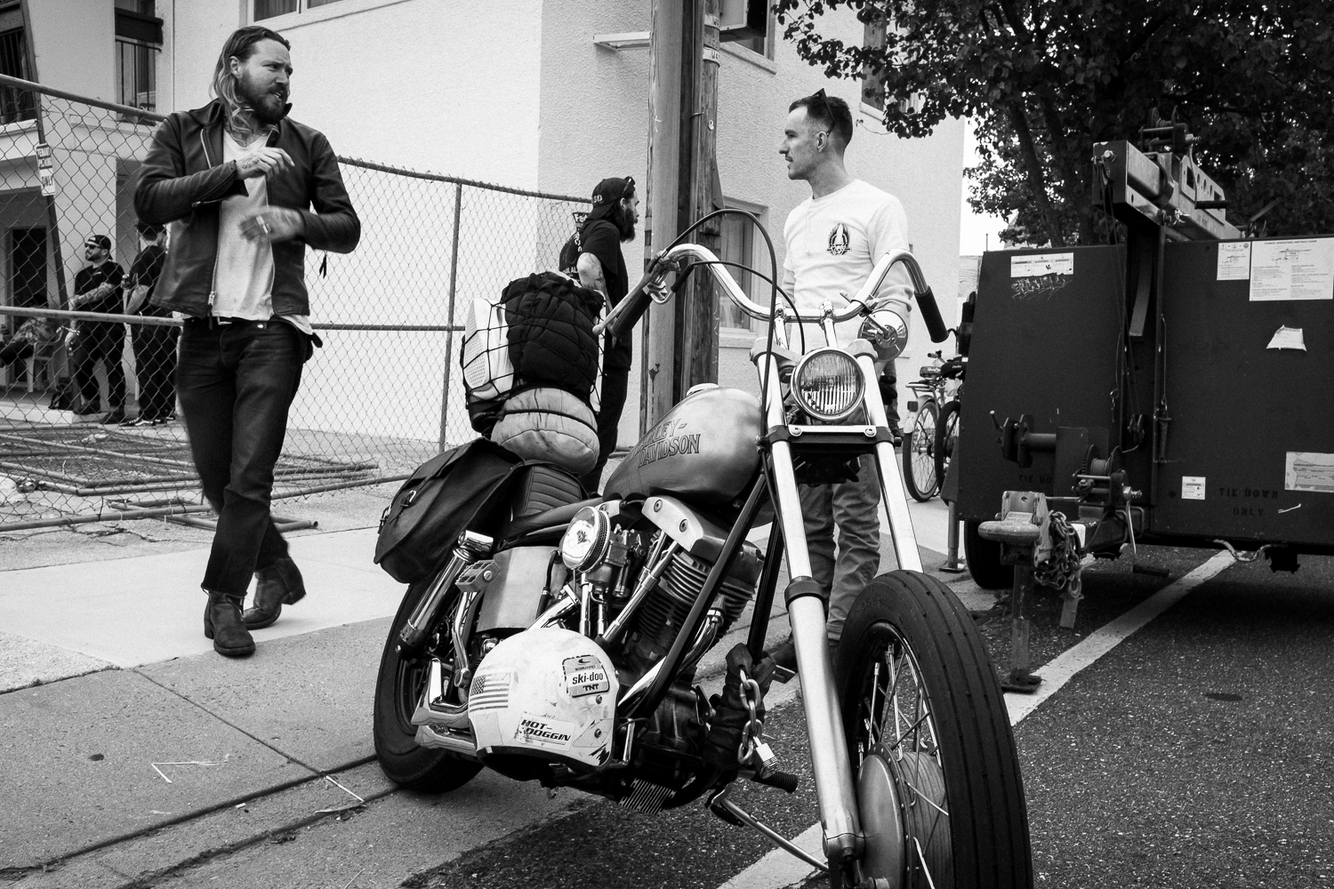 Bikers with a Harley Davidson chopper at The Night of the Troglodytes before The Race of Gentlemen gets started.