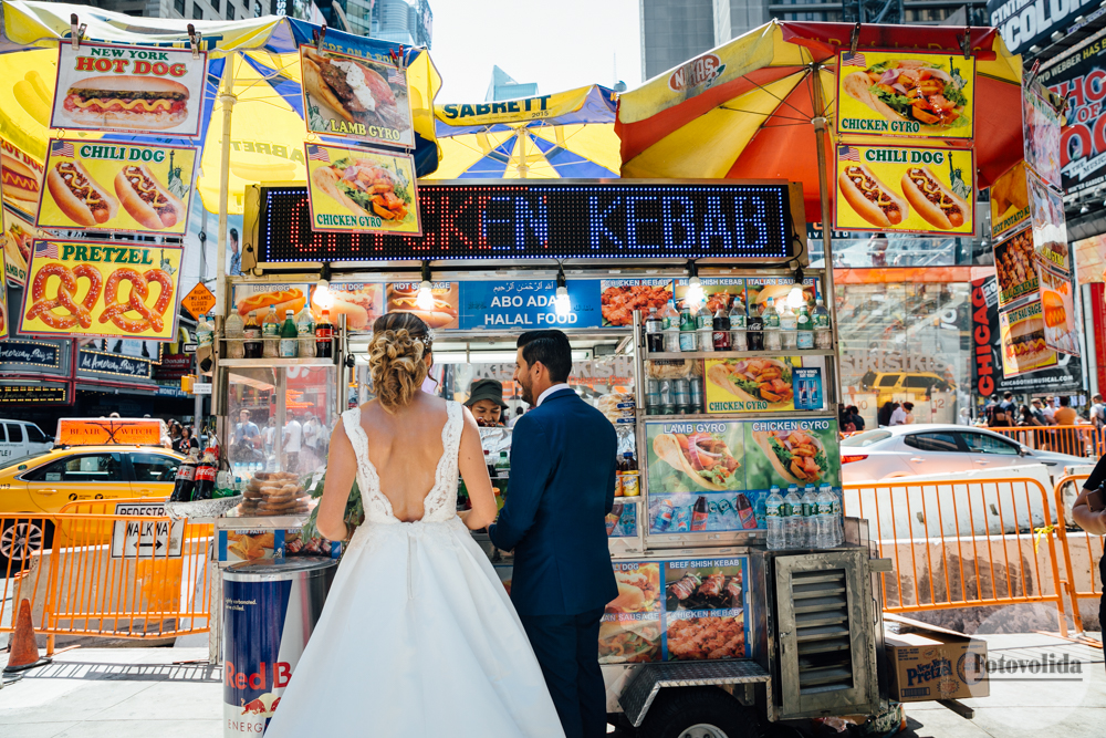 Bride and groom at Hot Dog stand in Times Square