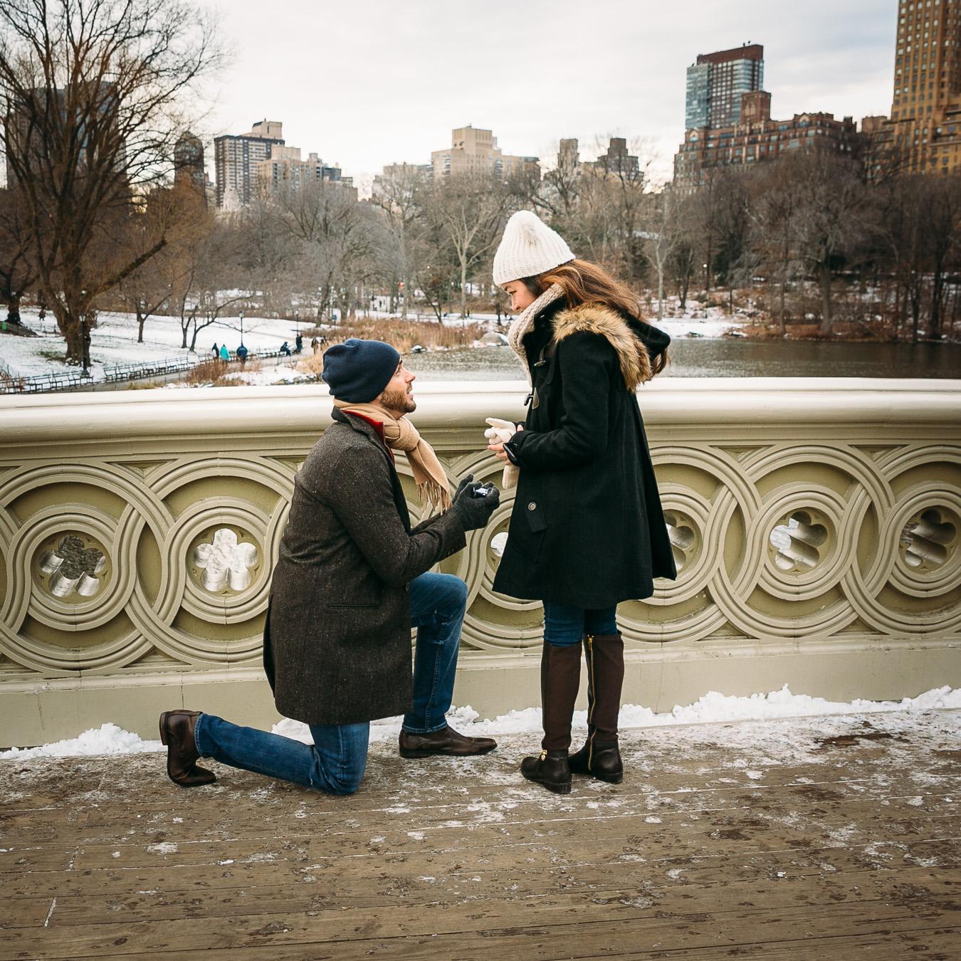 Surprise proposal at Bow Bridge in Central Park