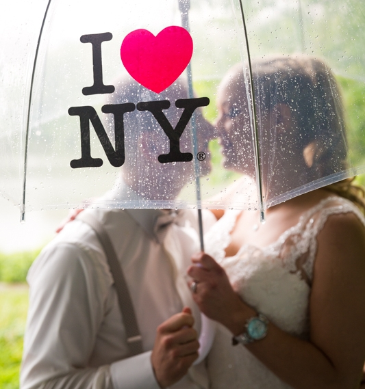 Rainy wedding day with I love New York umbrella