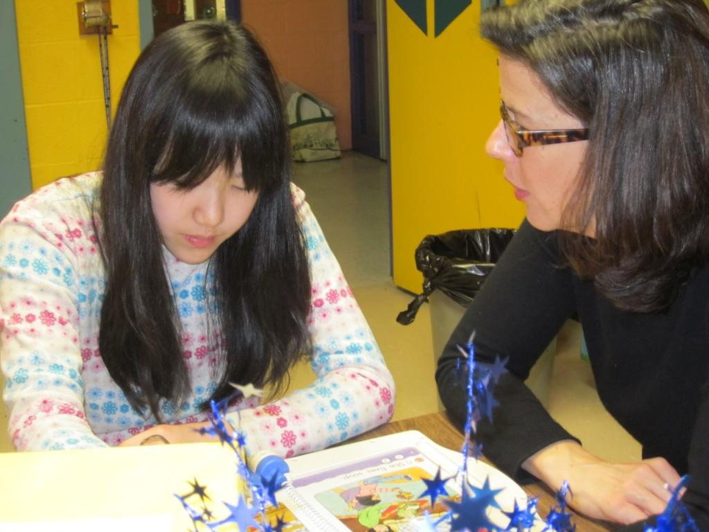 ELL teacher, Deidre, works with a 5th grade student from Japan