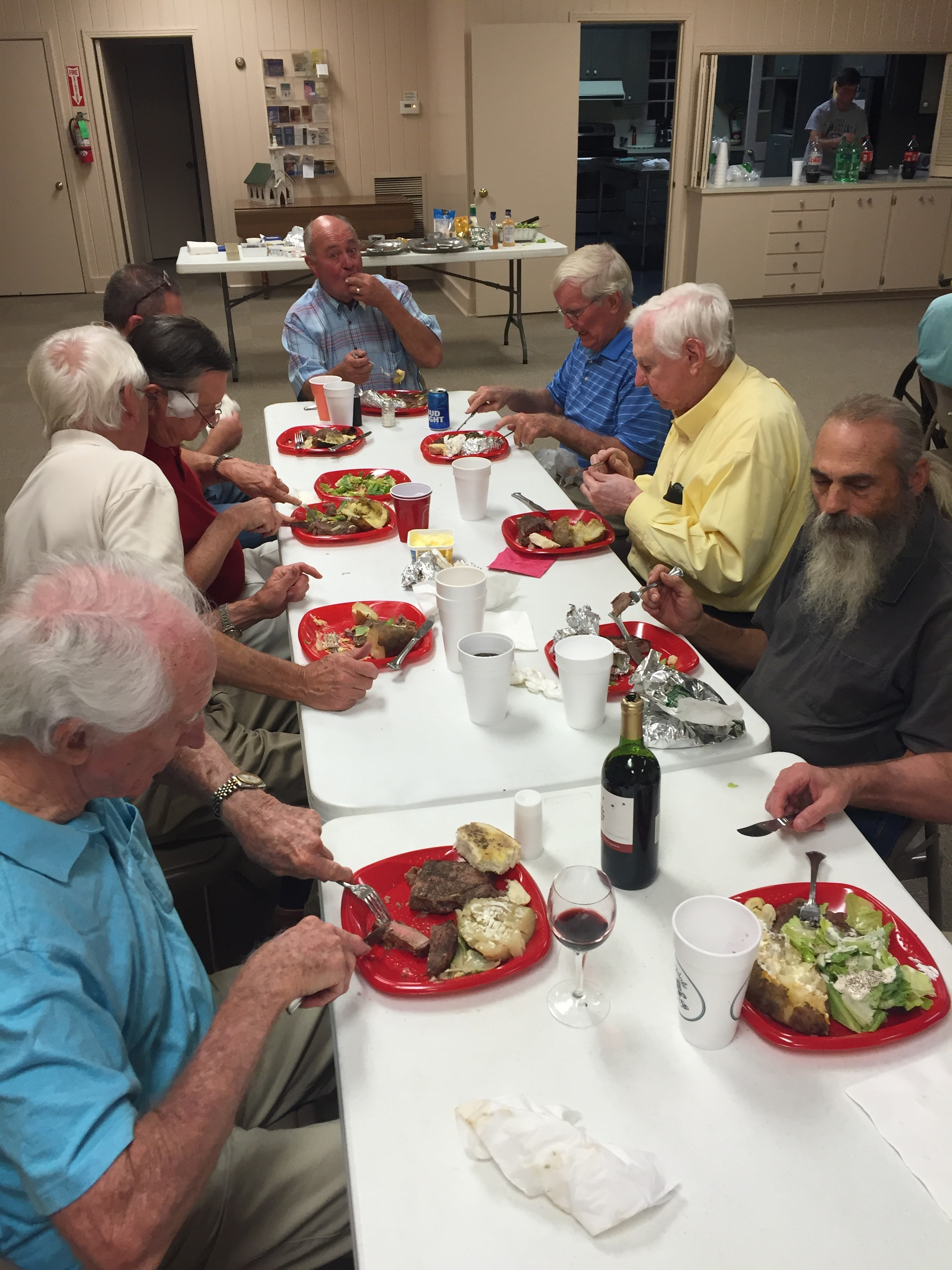 Church Men Enjoying Fellowship During Steak Supper Gathering