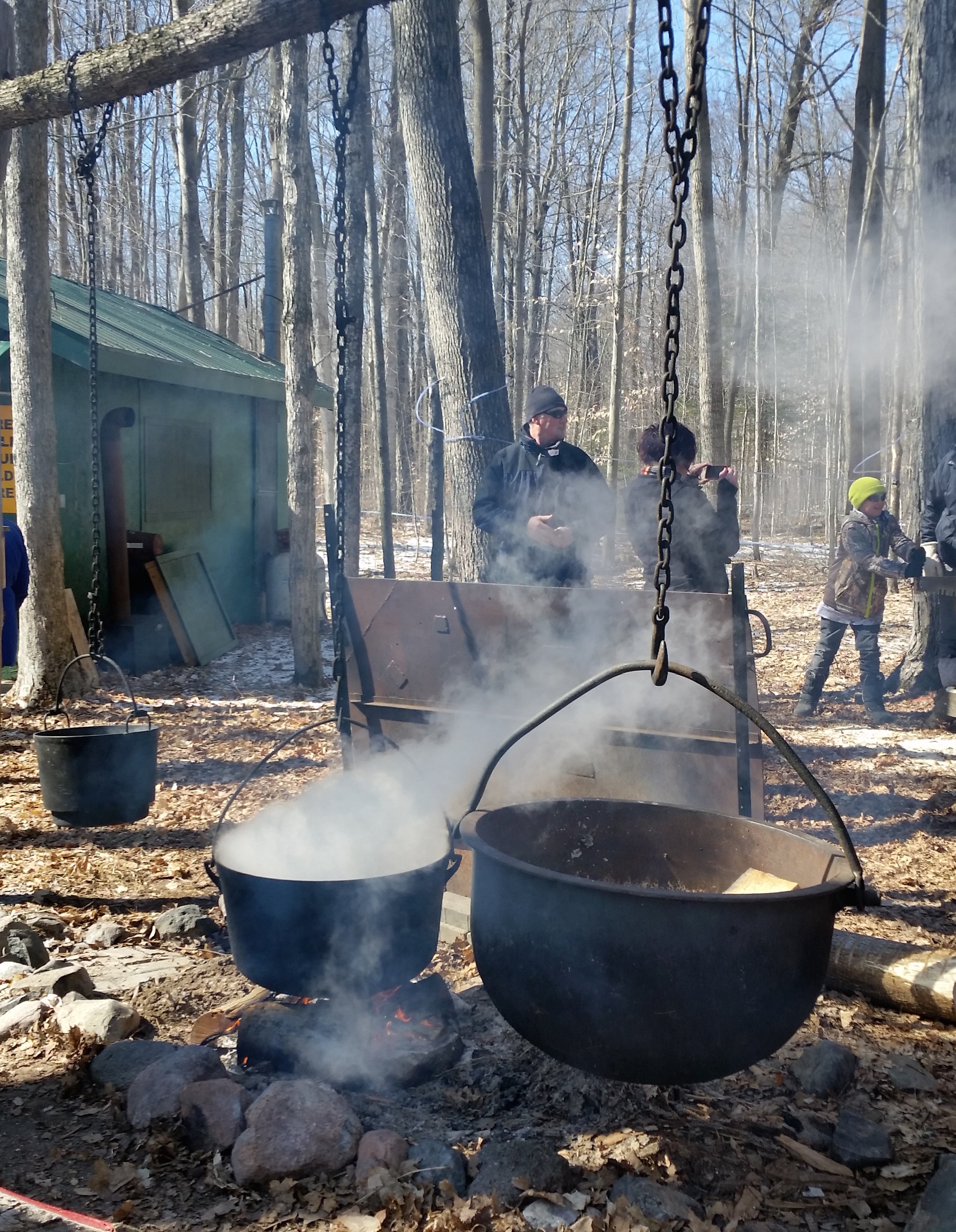 Boiling maple sap over an open fire.