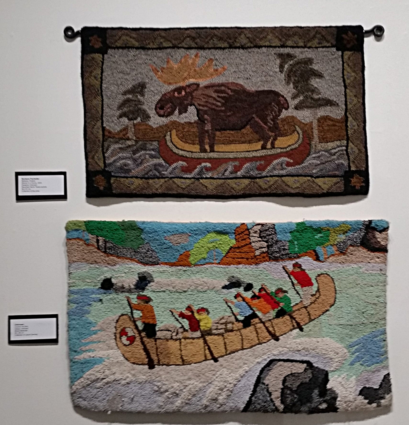 Some of the modern rugs on display.  Top:  Moose in a Canoe, Barbara Fierheller. From the collection of the artist.  Bottom: Coureur de Bois.  Artist unknown. From the collection of Laurie Deviney.