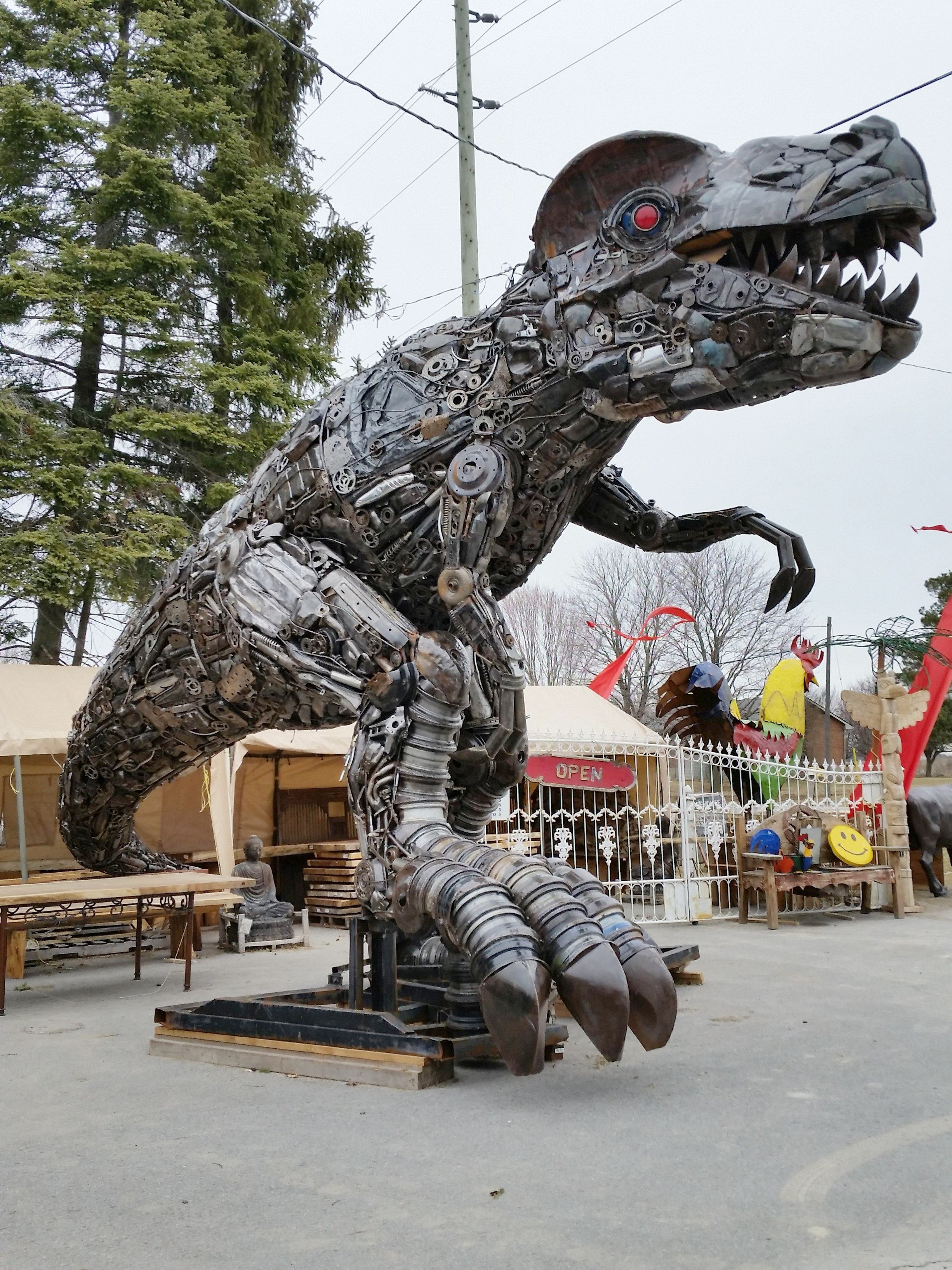 One of the three dinosaurs at Primitive Designs, over 20 feet tall and made from recycled auto parts.
