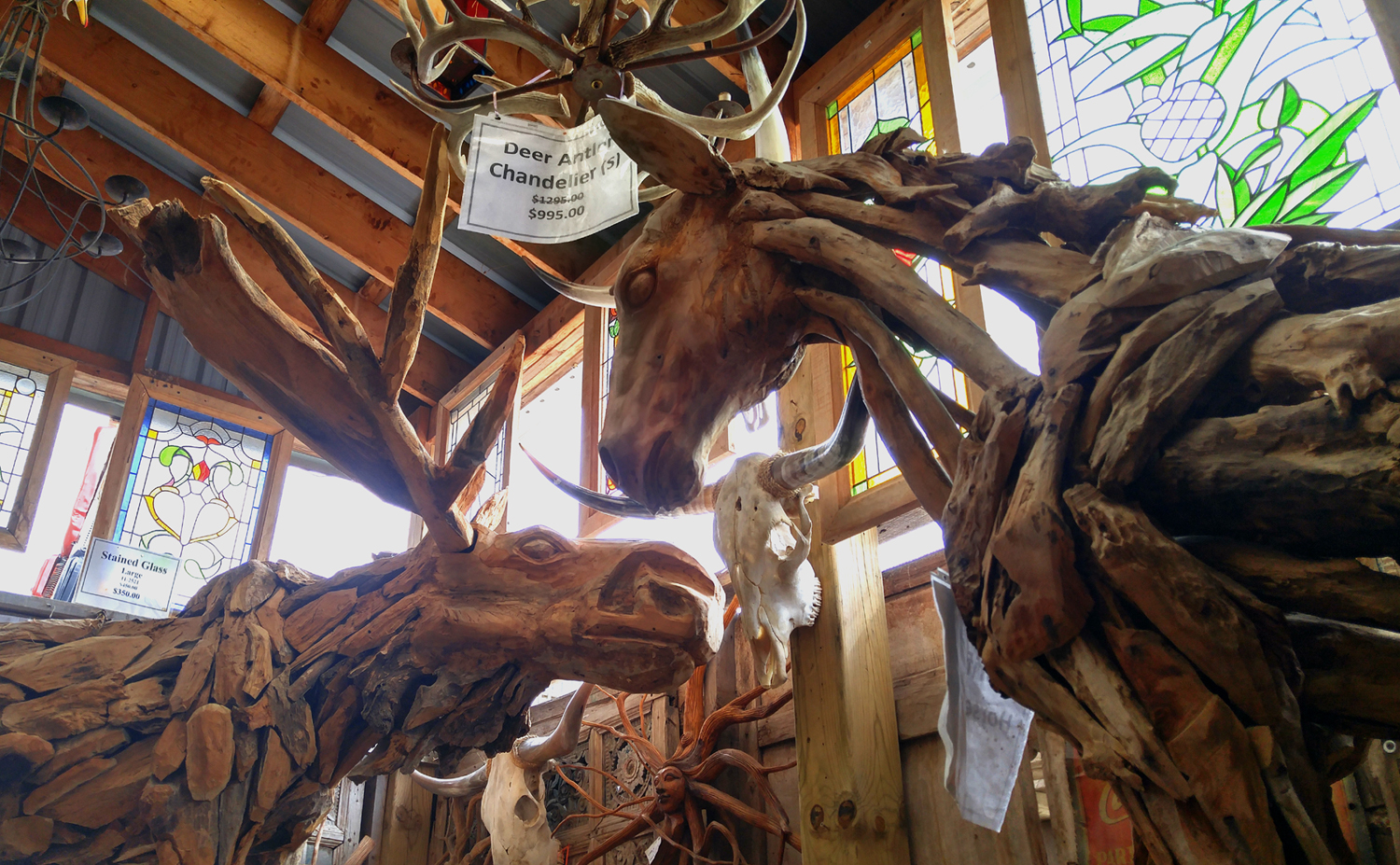 A life-size moose and horse, handmade from driftwood.