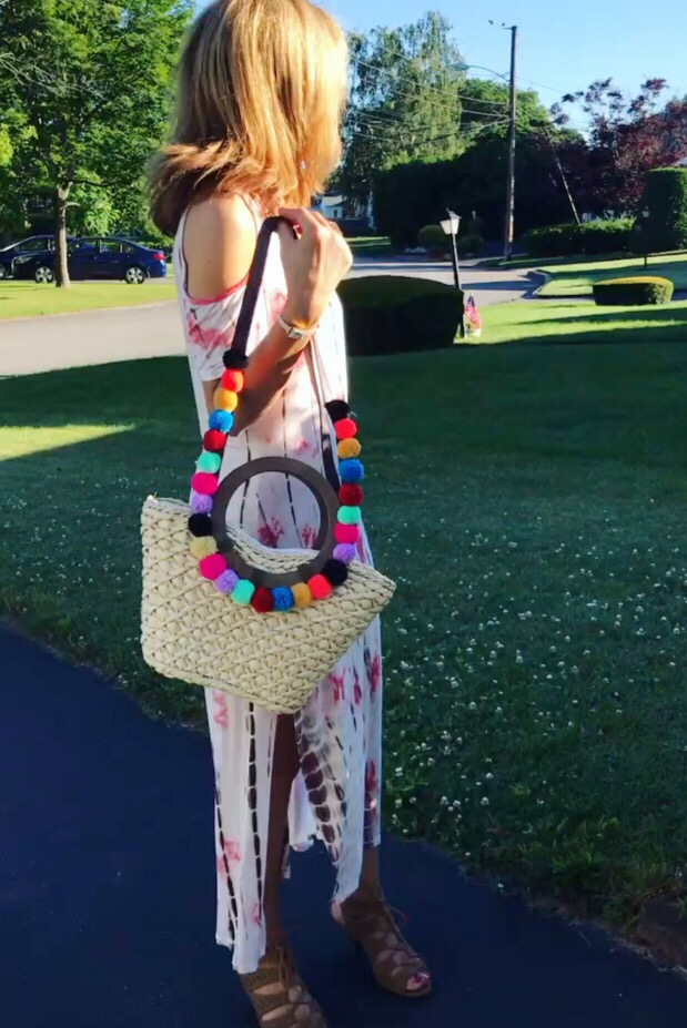 My Pom Pom Handbag is from Lila's Beauty Bag which you saw  here  and will see again! I totally promise! Purchase it  here . My tie dye cold shoulder dress is from Madstyle and you can find all the details  here .