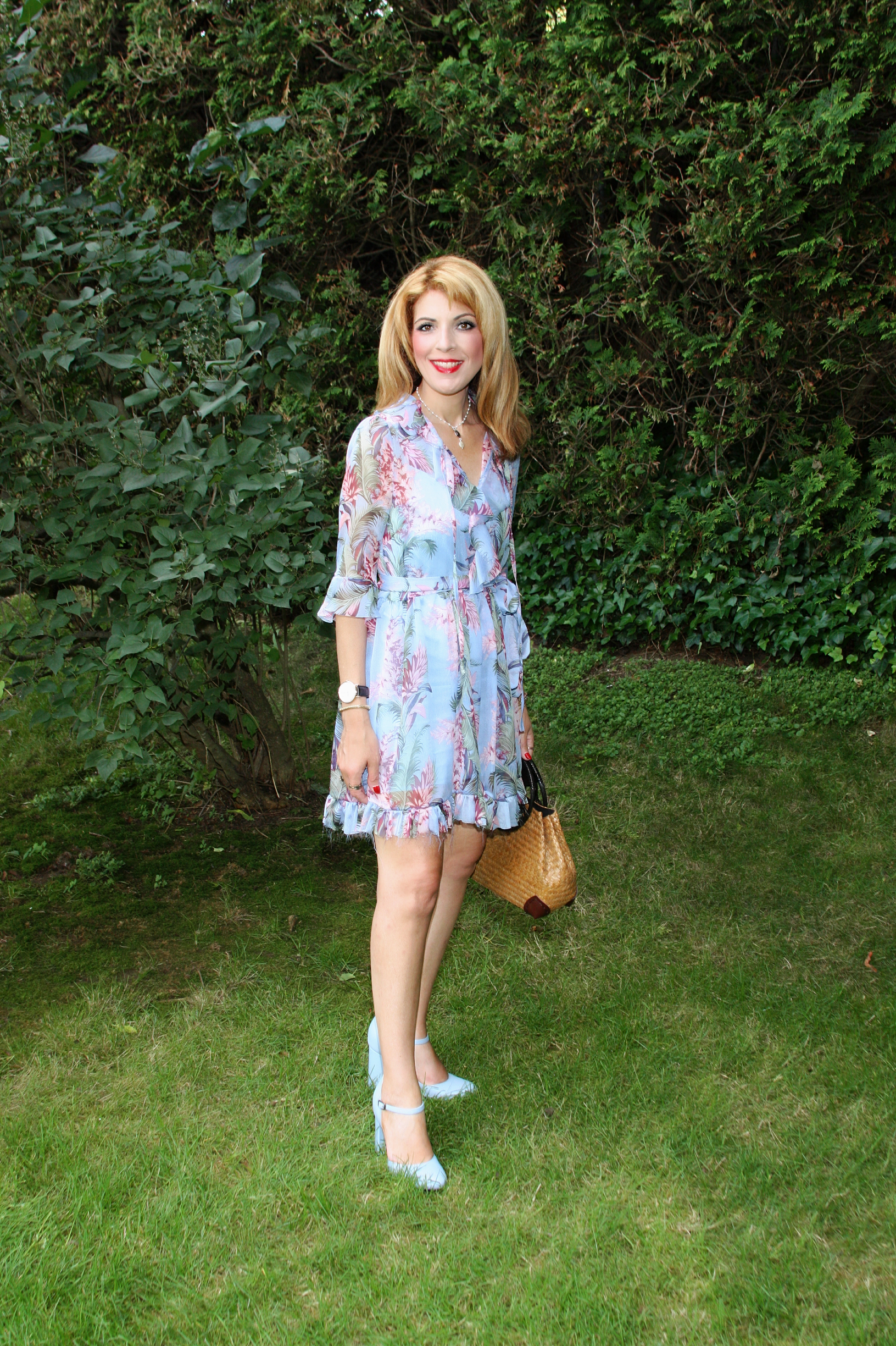 Find the Belted Fringe Dress with Flowers  here .