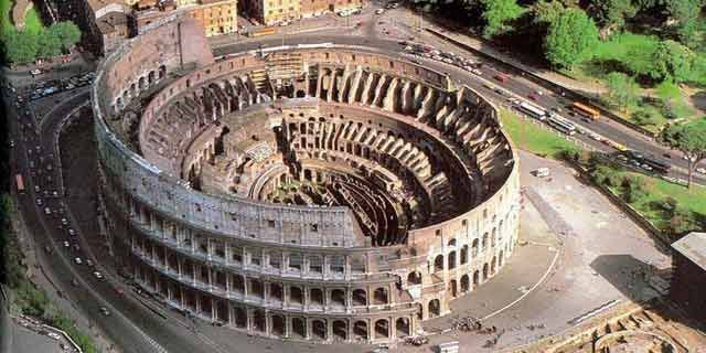 You can see the structure under the stage floor in this picture of the Coliseum.