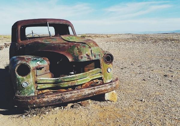 beat up car in namibia desert