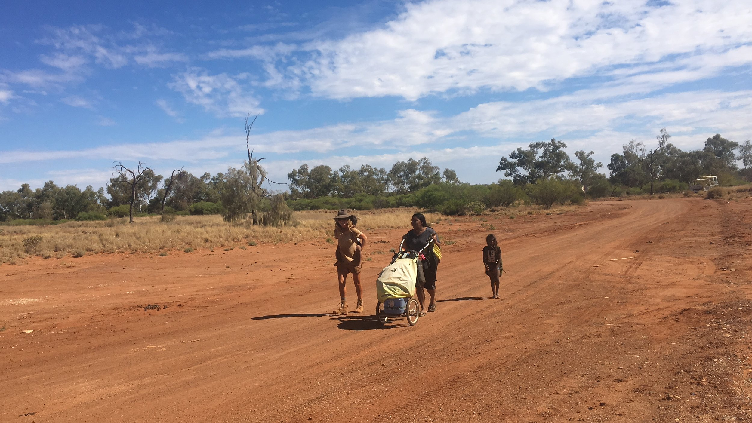 Walking into Jigalong with Maria, Molly's daughter