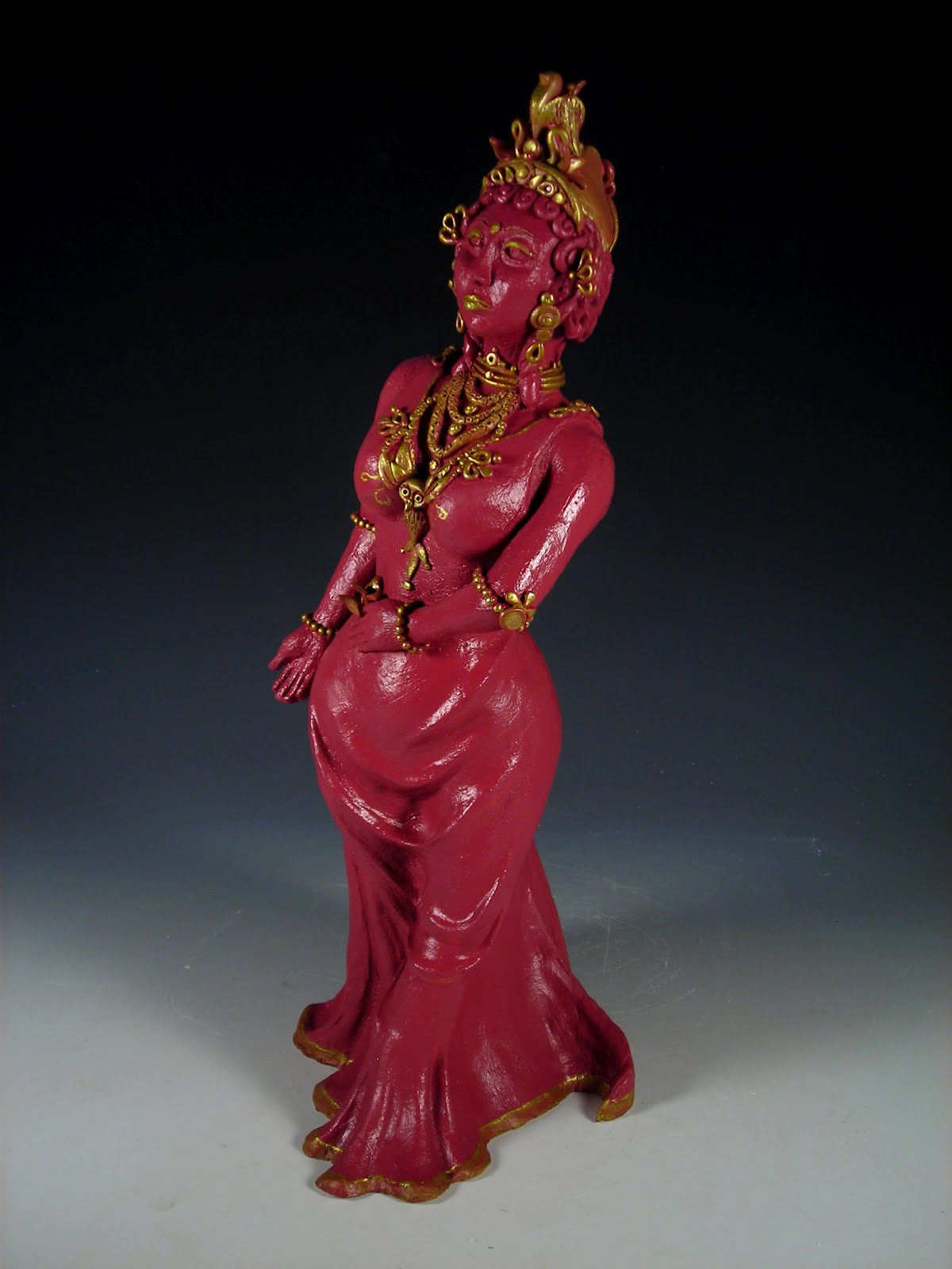 "14"" tall.  Red clay (kiln-fired), spray paint, polymer clay."