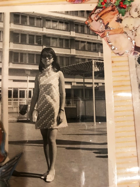 1972, age 22. My mother bidding farewell to my dad at the Hong Kong airport in her favorite handmade orange and white polka dot dress.