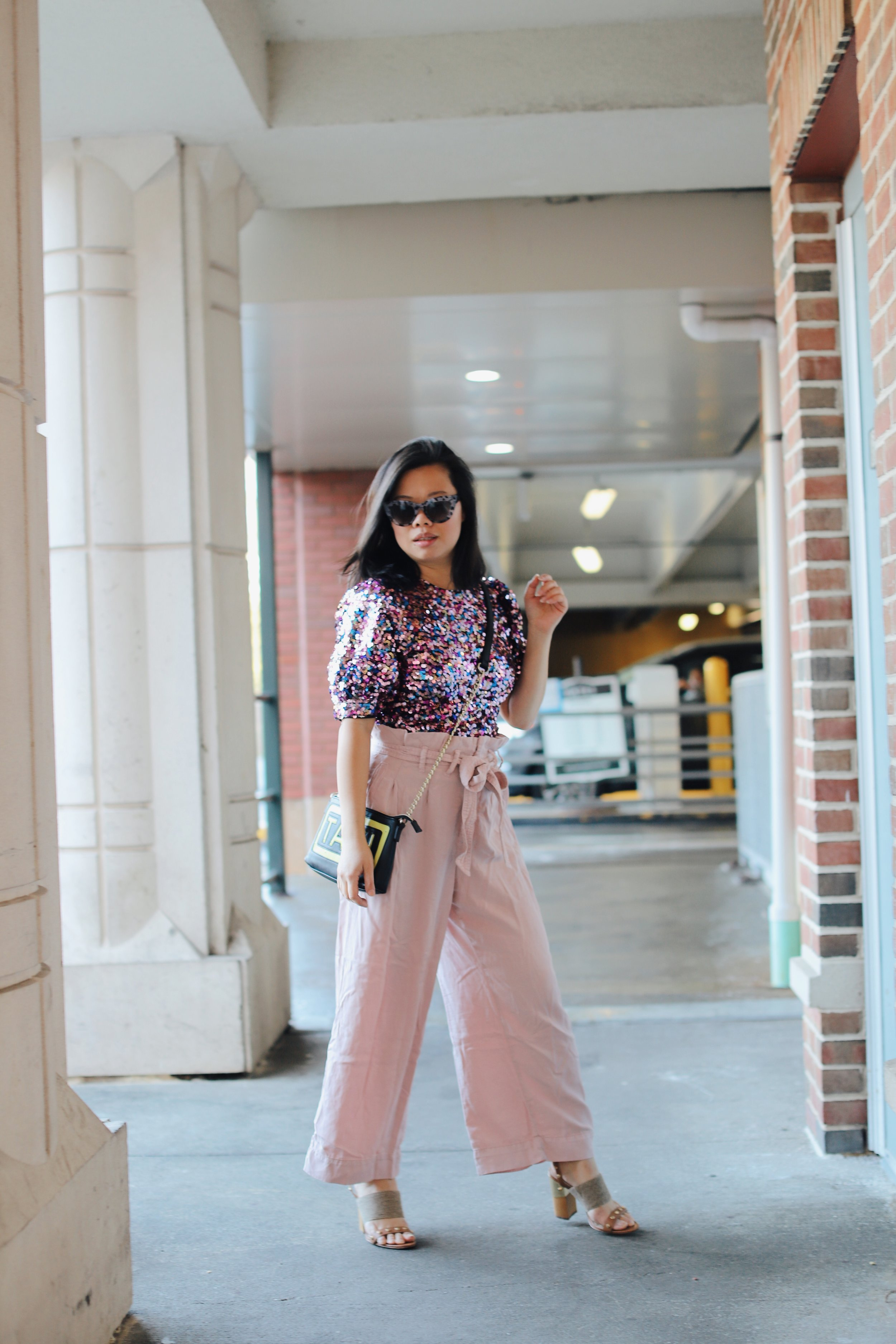 Wearing   Majorelle sequin top     from Revolve,  Anthropologie  pants (old), Louise et Cie shoes from  Nordstrom  (old),  Betsey Johnson  bag (old)