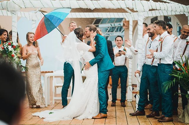 Rain? What rain?! 🌧️☔ ~ A moment I will never forget when these two braved the stormy weather, said their vows and were given the go ahead to seal the moment with help (☔) and encouragement from supportive family and friends. ~ I think my camera would have been less soaked if I dropped it in the sea 🌊🐚🐢, but every wet rainy moment was worth the risk ✌🏽💯