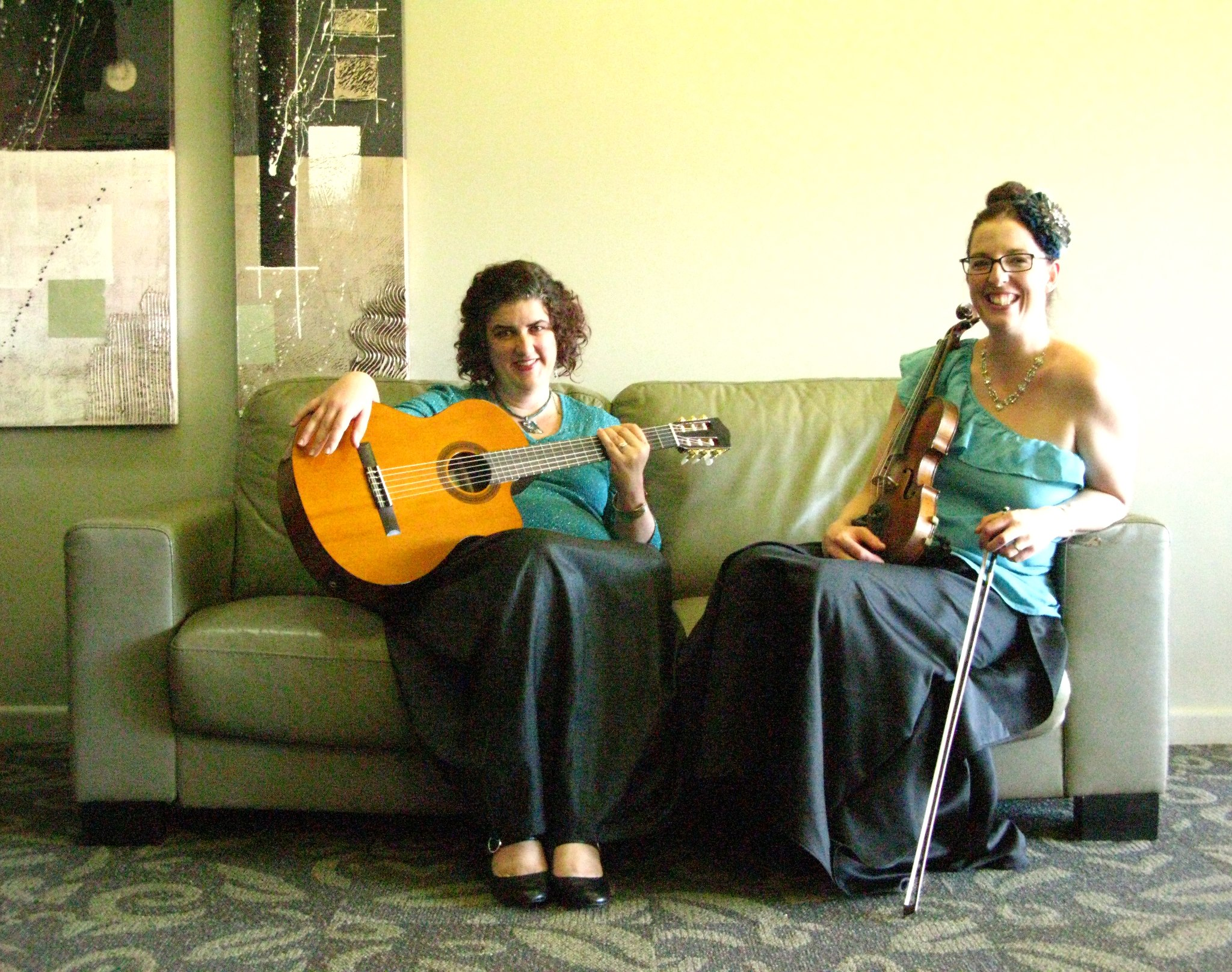 As classical guitarist in  Two Girls Ten Strings  with violinist Lizzie Walsh