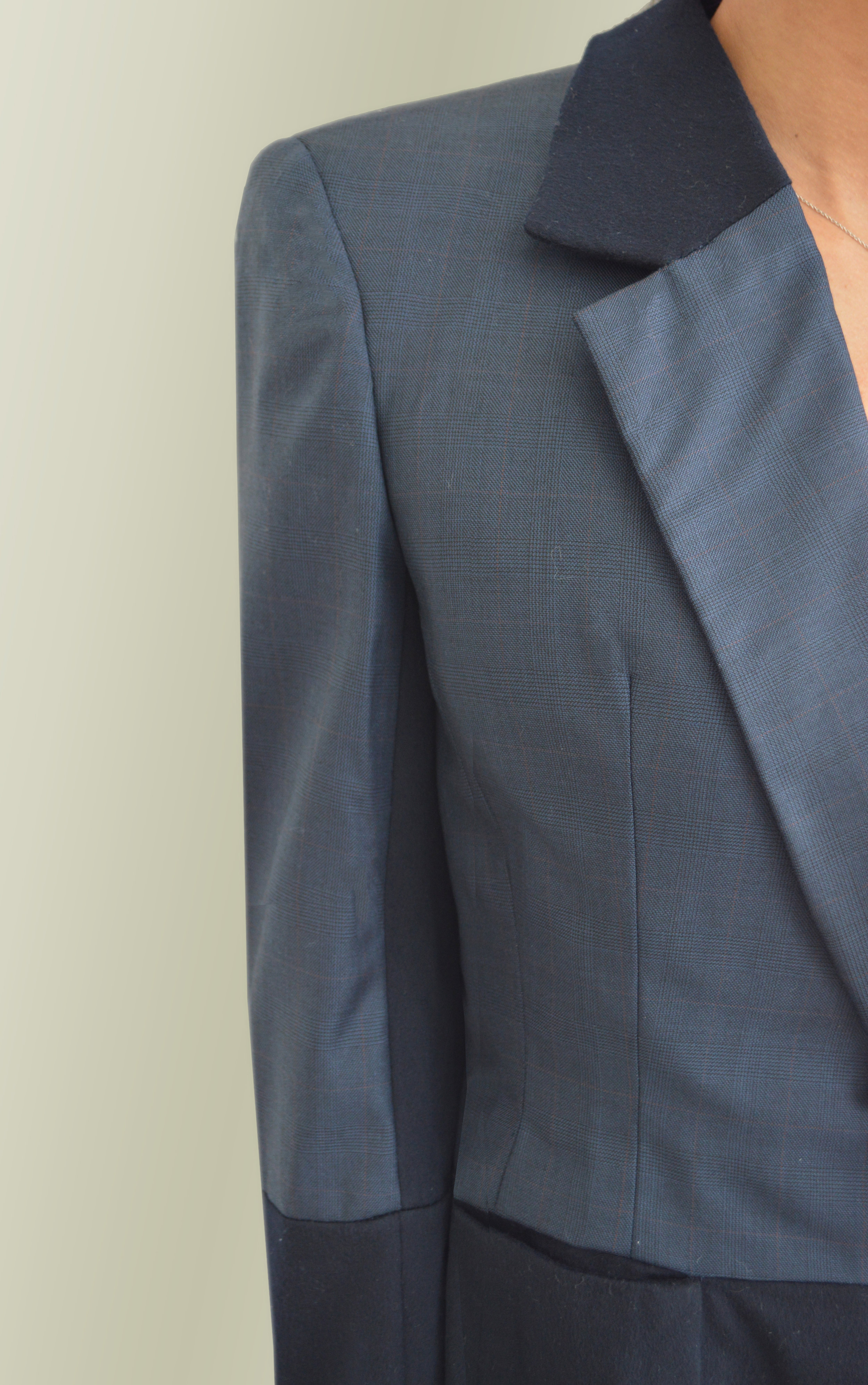Traditional tailoring - fitting - checking collar, lapel and sleeve roll