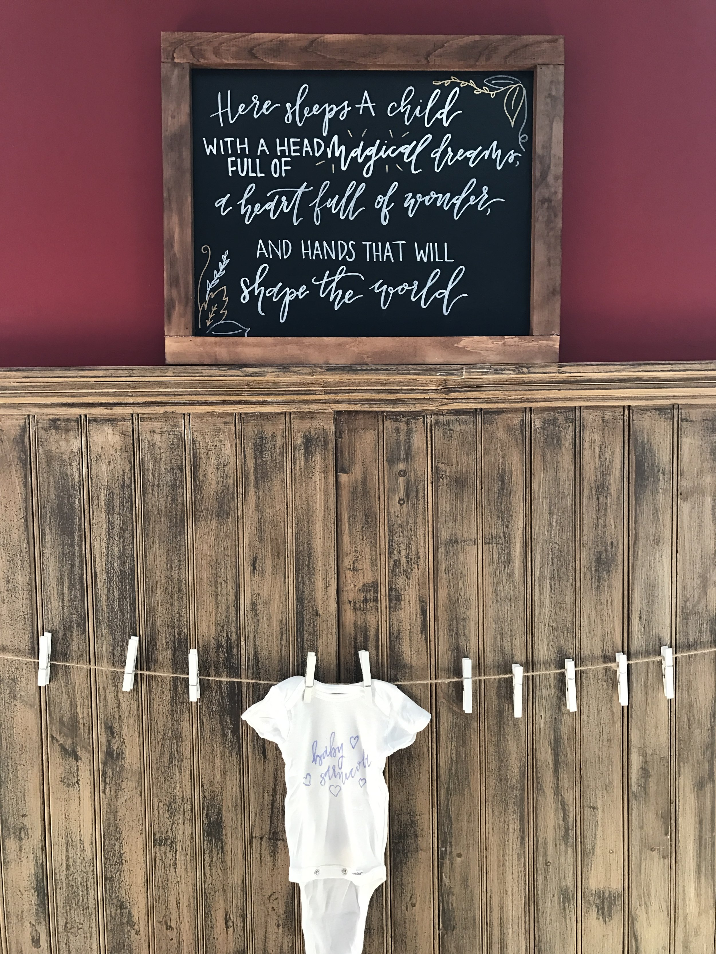 A clothesline lined the restaurant wall to later display all of the adorable onesies that guests created.