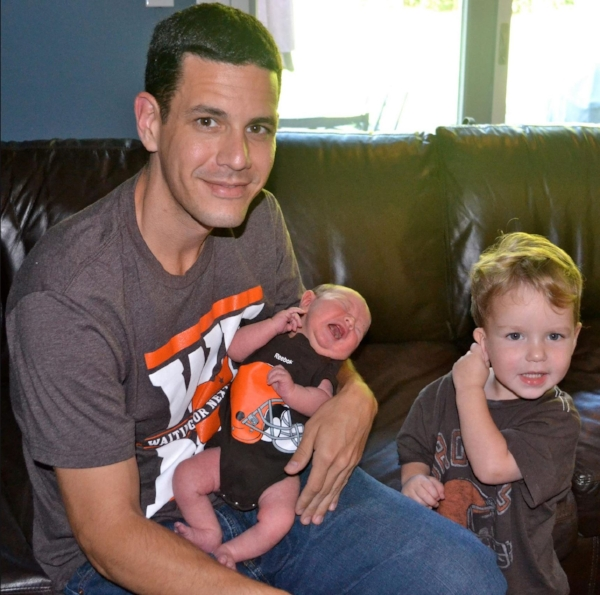 Craig (wearing his WFNY t-shirt) with his sons in 2012. Youngest, Will, took to being a Browns fan quickly, as you can see.
