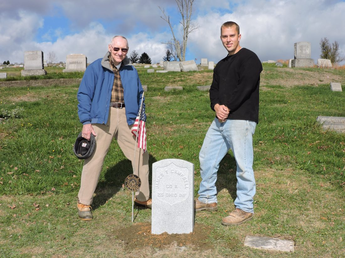 T-L Photos/SHELLEY HANSON ABOVE: GENE CAMPBELL, left, stands beside his great-great-grandfather's new Civil War grave marker at Riverview Cemetery that was provided by the Veterans Administration and installed by Justin Gallagher of Randall L. Gallagher Memorials.
