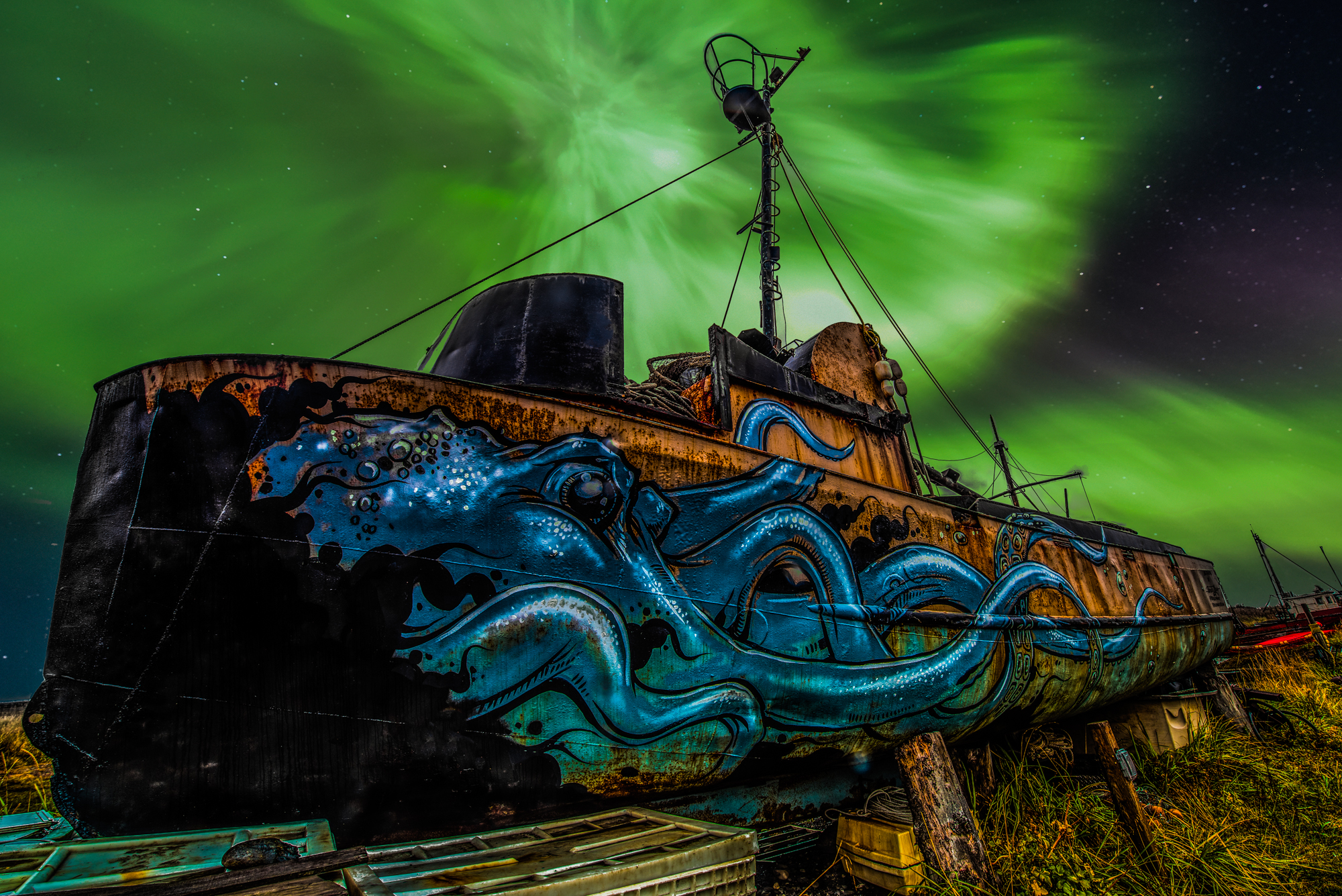 I photographed this abandoned ship in Homer, AK and I combined it with a northern lights photo I took the first night of my trip to make this powerful composite image.