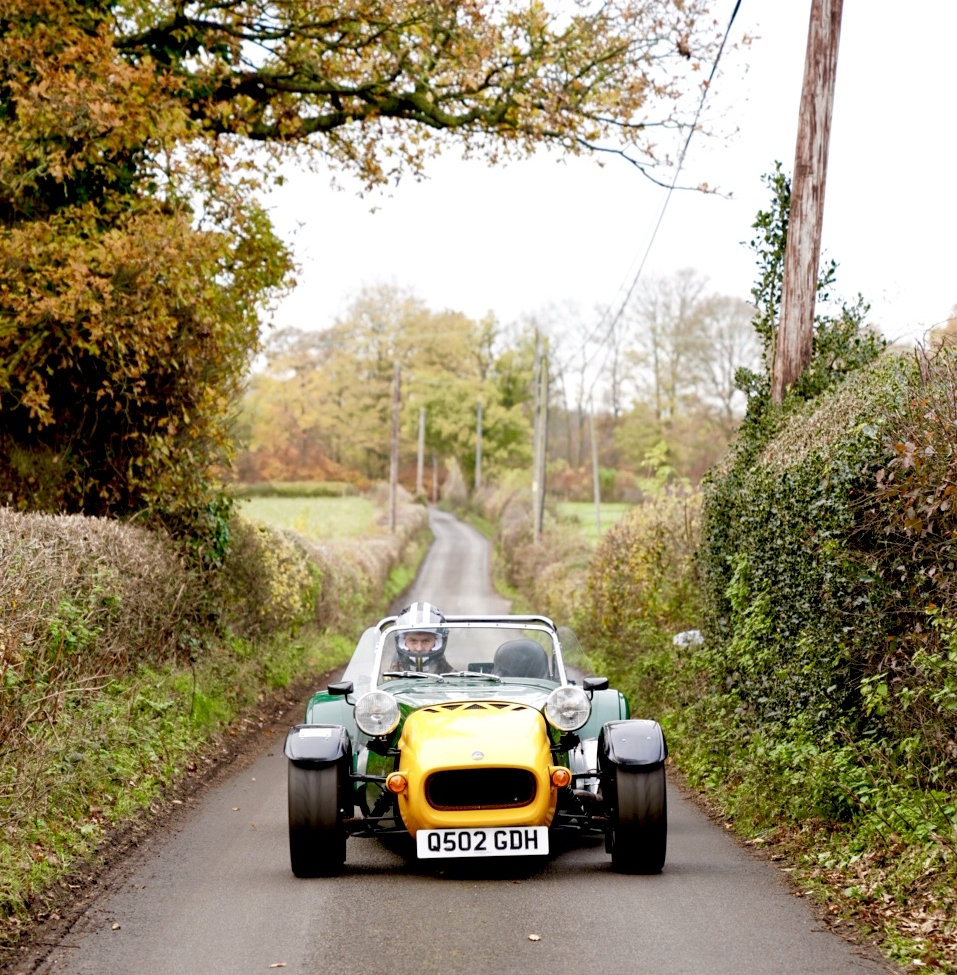 A man who loves his machines - Richard Quilter, entrepreneur, graphic designer, kit car builder, and Quinteman. Richard is a guy who would have it no other way than to build what he rides and drives. He inherited his passion for mechanics from his dad (pictured in the slider below standing next to his own kit car). Richard's friends say his preference for driving works-in-progress is inconvenient. He doesn't care. He lives to get his hands greasy.  Both Richard and his dad have assembled their own kit cars, which they work on improving a little each consecutive year. Richard is photographed with his Quin helmet.