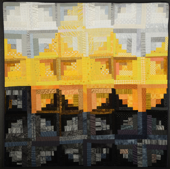 """One of Katie PM's artful log cabin quilts, """"Granada Sunset"""""""
