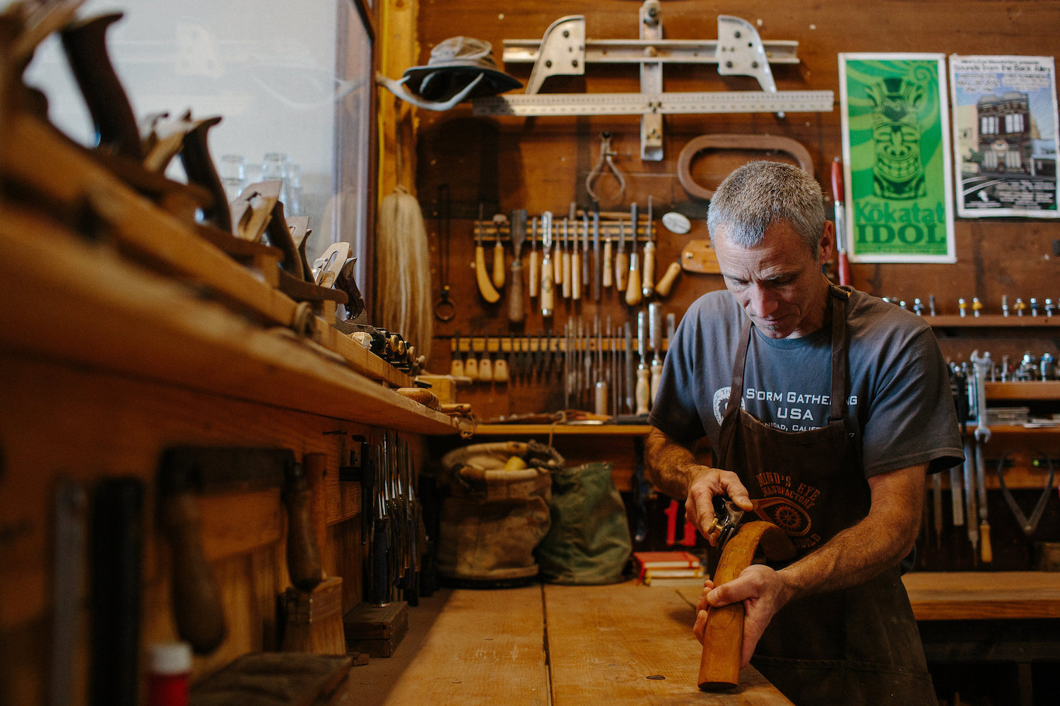 Marc Daniels of Mind's Eye Manufactory, a Ferndale studio and maker school taking part in this weekend's North Coast Open Studios, perfects a piece for a traditional skin-boat