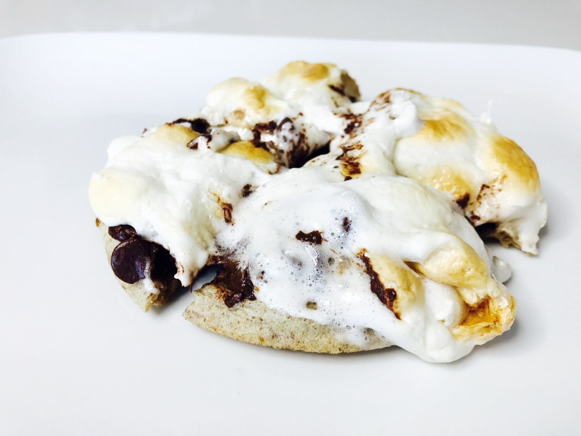 The chocolate chips and marshmallows melt perfectly into the waffle.  Cut the waffle into four triangles - and serve right away!