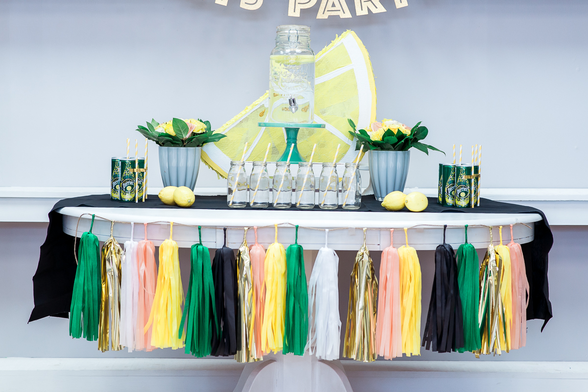 This freshly squeezed theme styled shoot brought together over a dozen businesses in a BEAUTIFUL COLLABORATION!  Planner:  Honey Lemon Events  // Photography:  Photography by Emma  // Location:  The Date Palm  // Candy:  Blossom & Bean  // Florals:  Tonic Bloom  // Cake:  Vanilla Bean Cakery  // Banner:  Best Day Ever Banners  // Tassel Garland and Confetti:  Genwoo  // Pinata:  Big Ass Pinatas  // Macarons:  Sugar Mama Events  // Cake Pops:  The Cakepop Kitchen  // Stroopwaffels:  Backpacker's Bites .