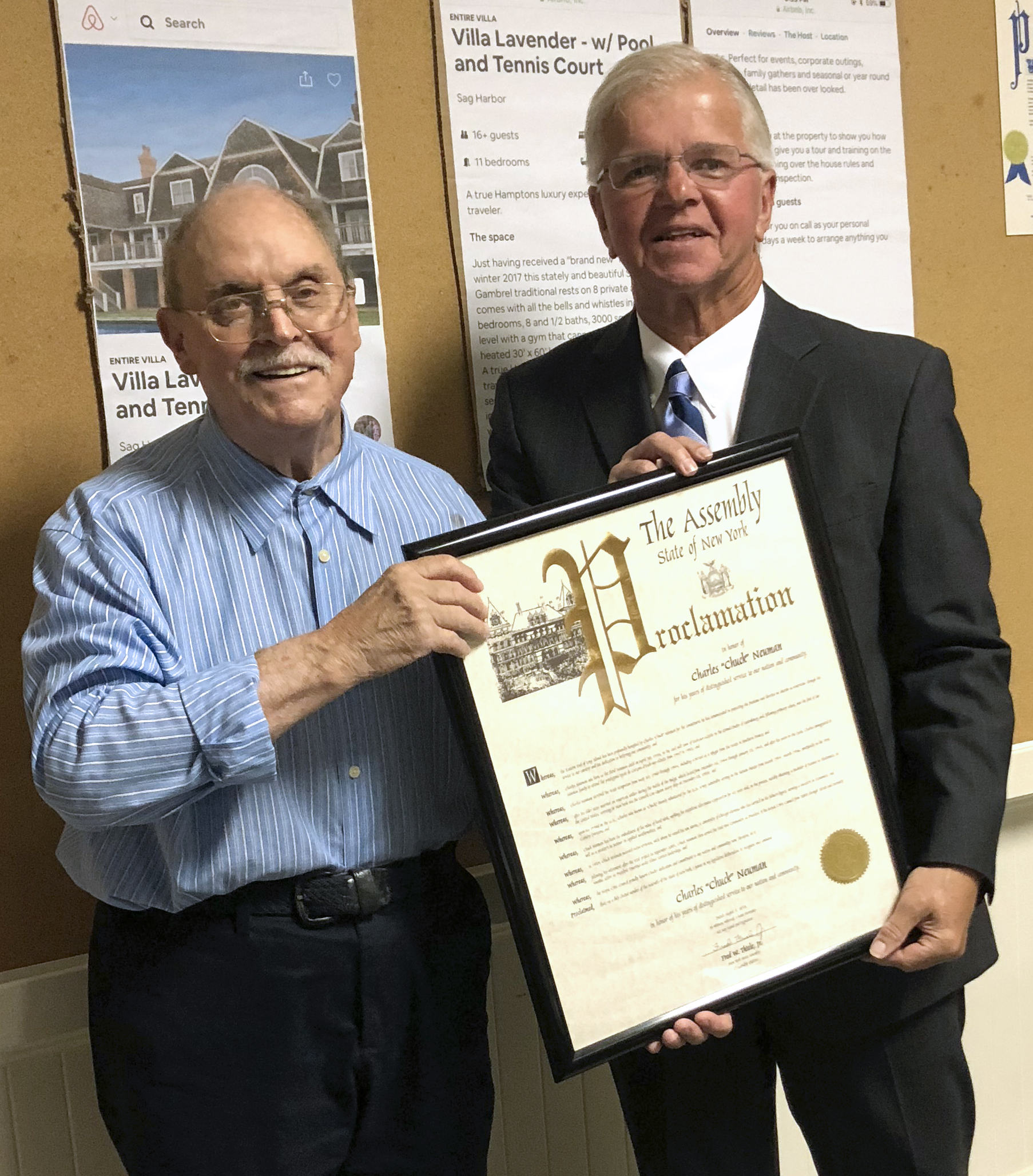 Charles Neuman receives proclamation from Assemblyman Fred Thiele